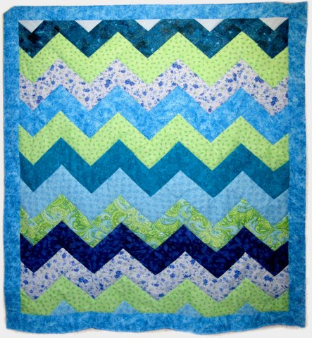 blue and green zigzag baby quilt